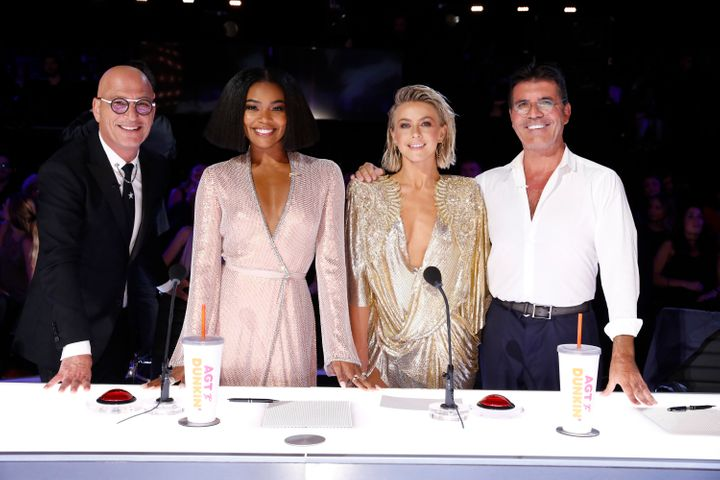 "Howie Mandel (from left), Gabrielle Union, Julianne Hough and Simon Cowell at the ""America's Got Talent"" judging table."
