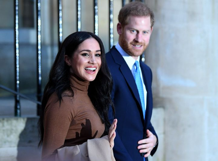 Harry and Meghan react after their visit to Canada House in thanks for the warm Canadian hospitality and support they received during their recent stay in Canada, on Jan. 7 in London.