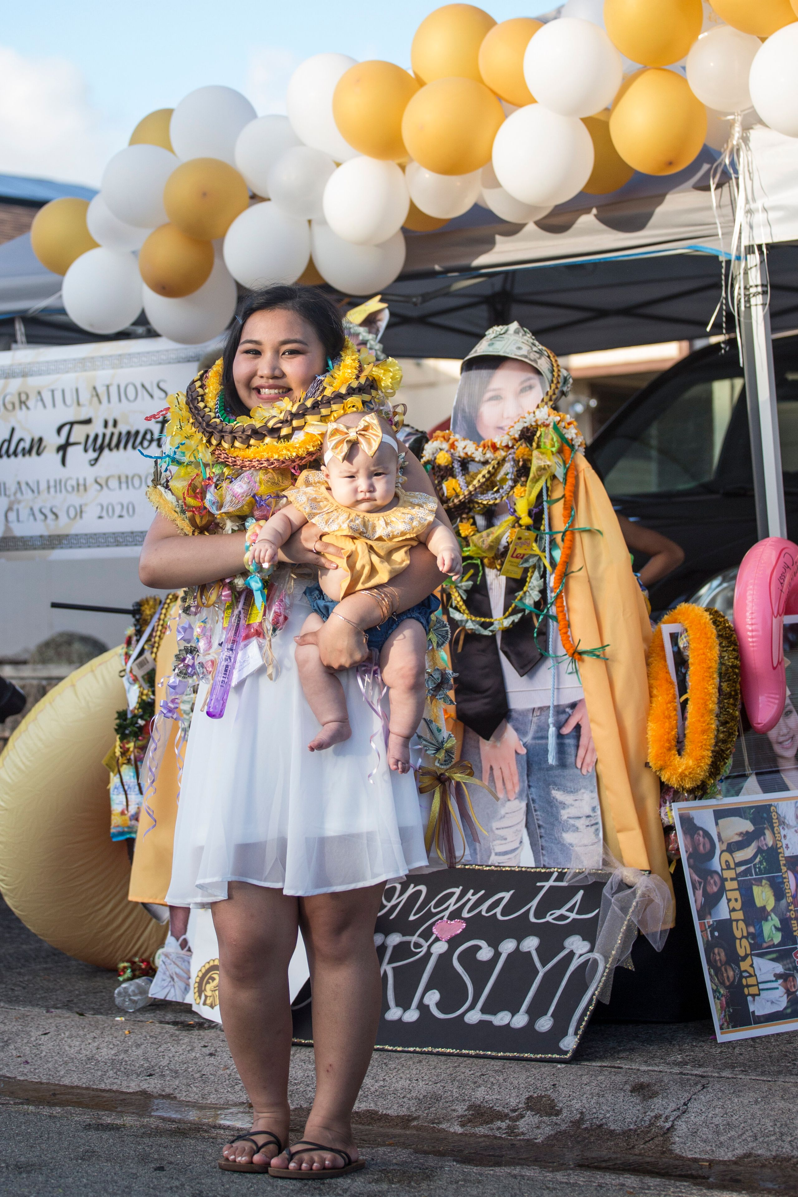 Chrislyn Antonio, a Mililani High School graduate, with her daughter, Embrie-Rose Lanias, in Mililani, Hawaii. Antonio h