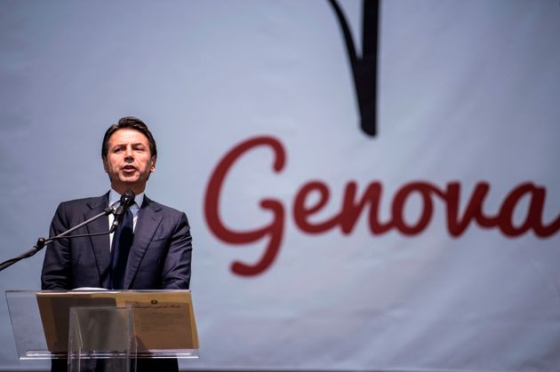 Italy's prime minister Giuseppe Conte delivers a speech during a commemoration ceremony one month after...