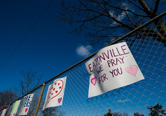 Supportive signs for health-care workers hang on a fence across the street from the Eatonville Care Centre...