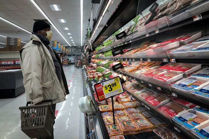 A man shops in the meat section at a grocery store in Washington, DC on April 28.