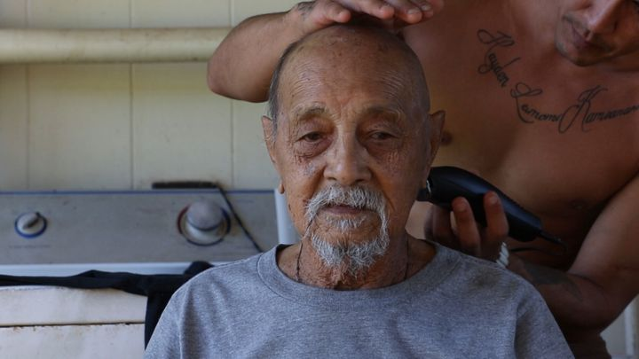 The director's Great-Uncle Henry getting his hair cut in a scene from the documentary.