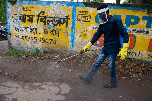 Member of the cleaning staff disinfect a street in Tehatta, Nadia, West Bengal, India on May 27, 2020....