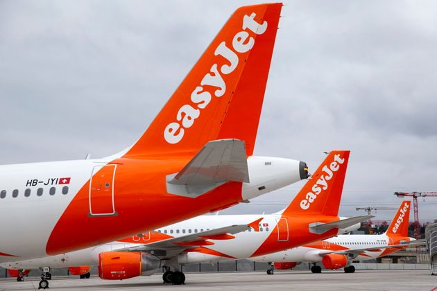 A large number of easyJet aircrafts are parked on the tarmac of the Geneve Aeroport, in Geneva, Switzerland,...