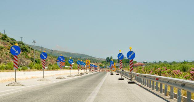 road works ahead on the street blue arrow round