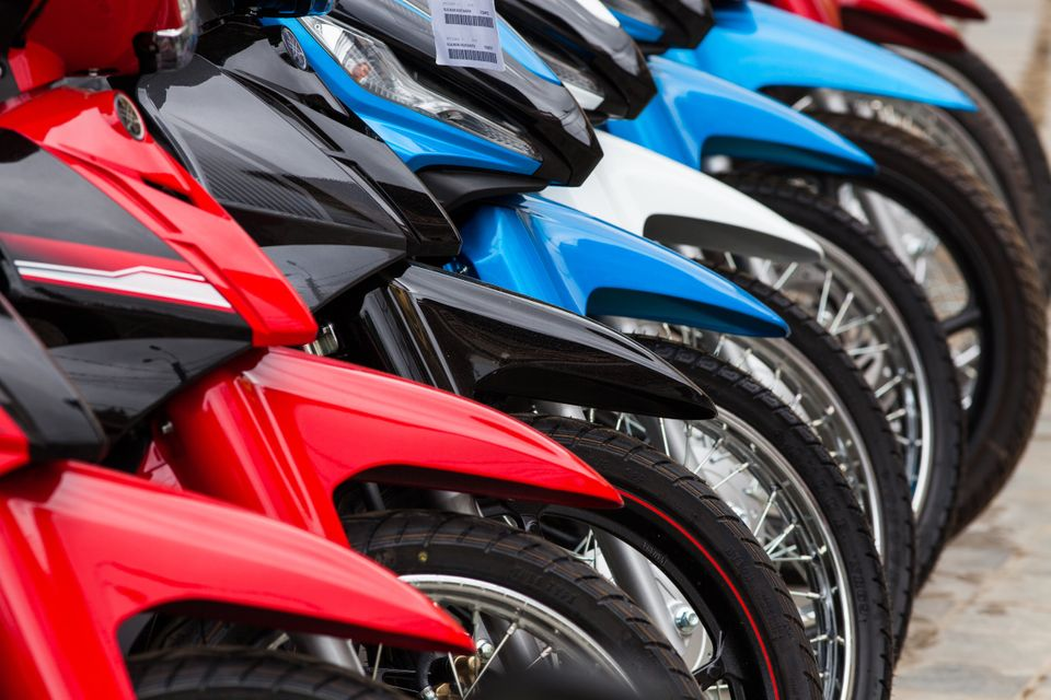 row of new motorbikes for