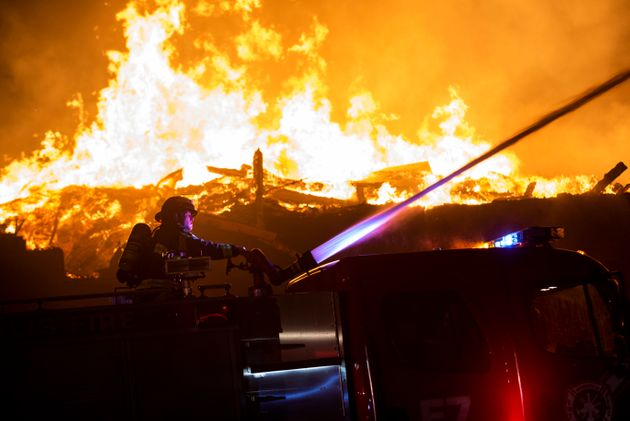 MINNEAPOLIS, MN - MAY 27: Fire fighters work to put out a fire at a factory near the Third Police Precinct...
