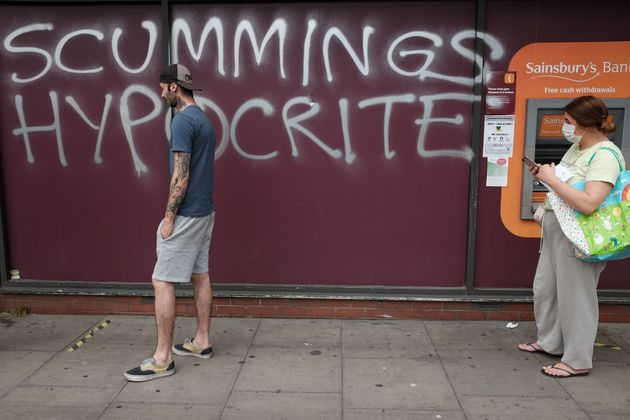 Graffiti protesting against Dominic Cummings is sprayed on a supermarket wall near his north London home,...