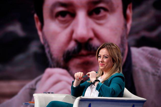 Italian politician Giorgia Meloni guest at Porta a Porta television broadcast, in the background Matteo...