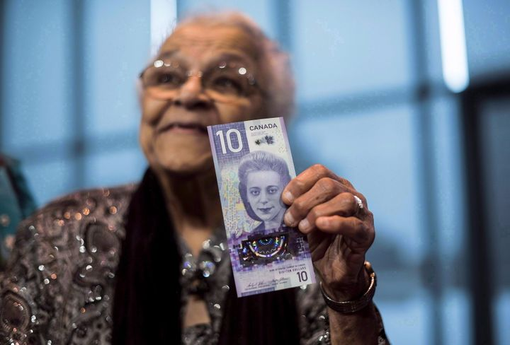 Viola Desmond's sister, Wanda Robson, holds the new $10 bank note featuring Desmond during a press conference in Halifax in March 2018.