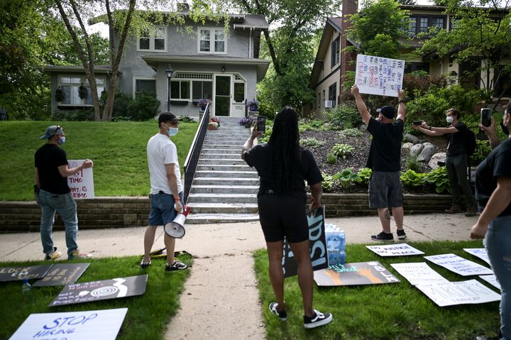 Protesters angered by the death of George Floyd stand Wednesday outside the home of Hennepin County Attorney Mike Freeman in