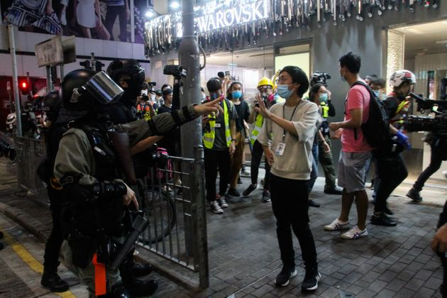 Police and press argue during evening street protests in the district of Mongkok, Hong Kong, 27th May...