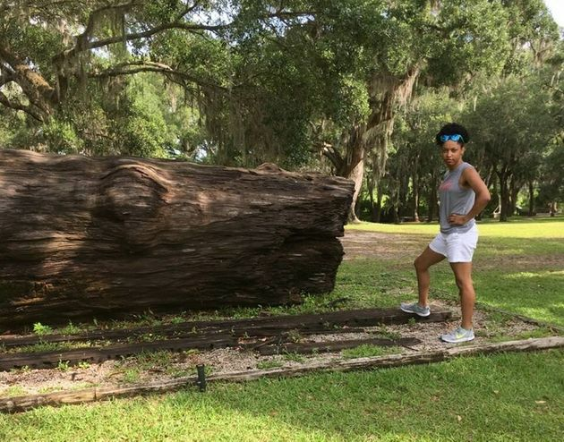 The author standing next to a log that slaves cut down at a South Carolina rice