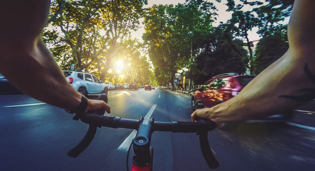 POV commuter riding a road racing bicycle in the