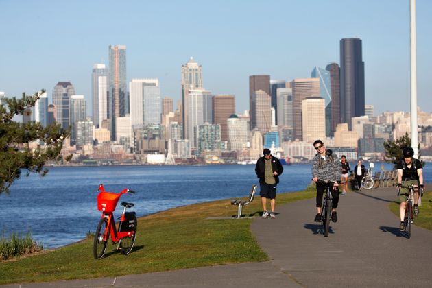 Cyclists at Seattle's Alki Beach Park on March 20. The city is creating new bike lanes and expanding