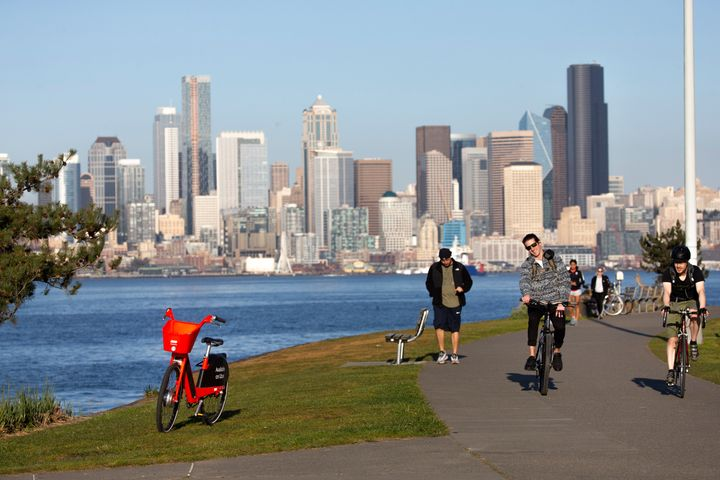 Cyclists at Seattle's Alki Beach Park on March 20. The city is creating new bike lanes and expanding sidewalks.
