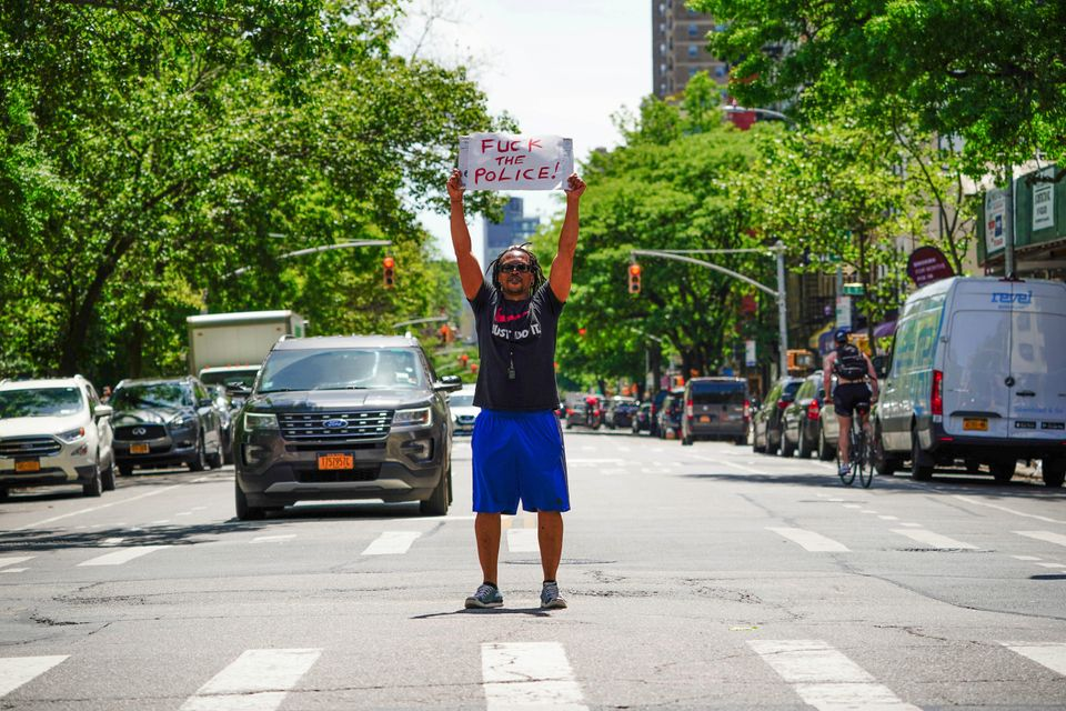 A view of East Village artist, Ian Dave Knife staging a protest in New York