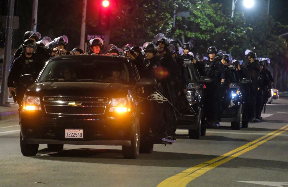LAPD riot police stand by outside City Hall on Wednesday