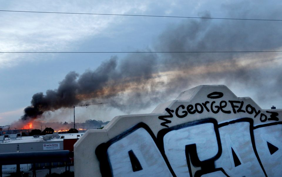 Smoke fills the sky after a night of unrest and protests in the death of George Floyd early