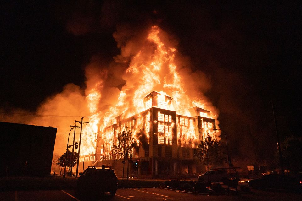 A multi-story affordable housing complex under construction near the Third Precinct, burns on Wednesday...