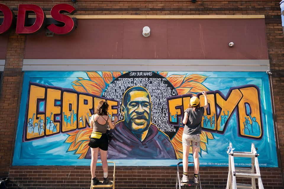 Artists complete a mural of George Floyd outside of Cup Foods in