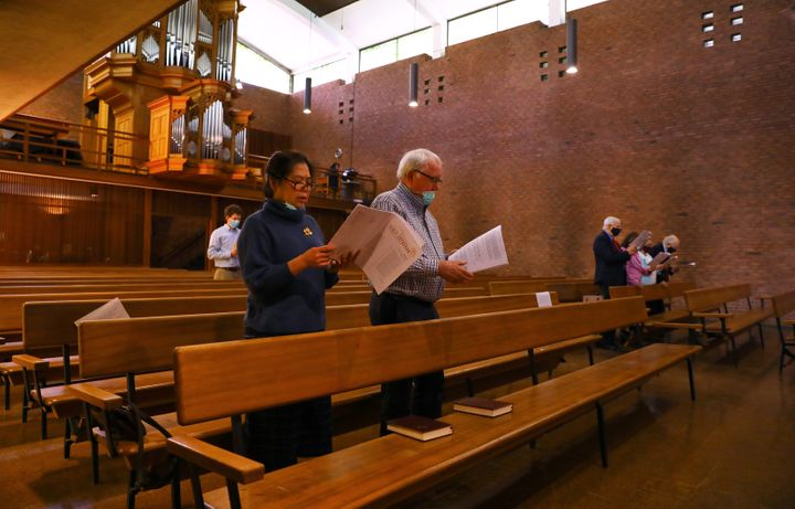 Maria and Siggi Birkis attend a service in the First Lutheran Church in Boston on May 24. They had to make reservations to at