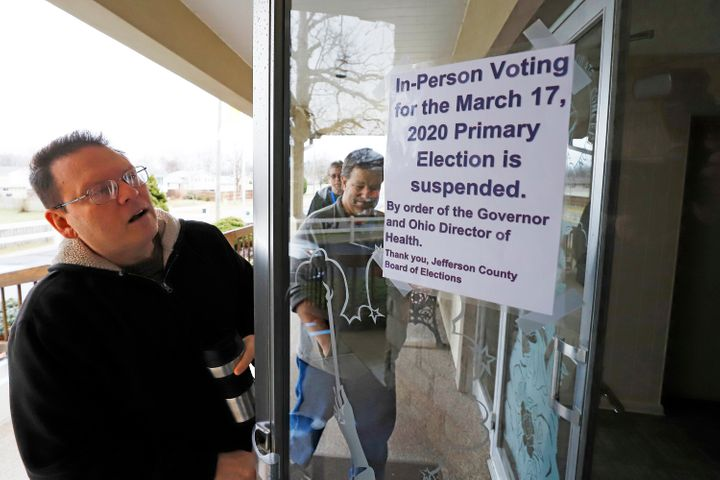 Jefferson County Elections workers arrive to pack up a polling place in Wintersville, Ohio, on March 17, 2020. Ohio's primary