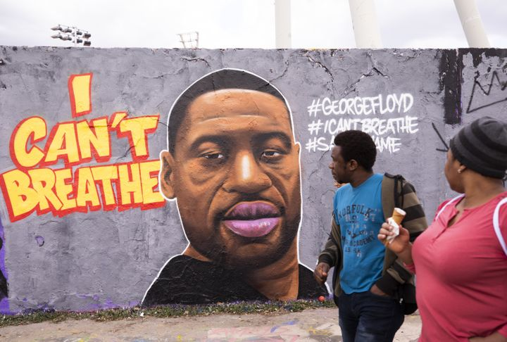 Citizens visit Mauer Park in Berlin on May 29, 2020 to check out a mural of George Floyd, who died in police custody in Minneapolis, Minn. on Monday night.