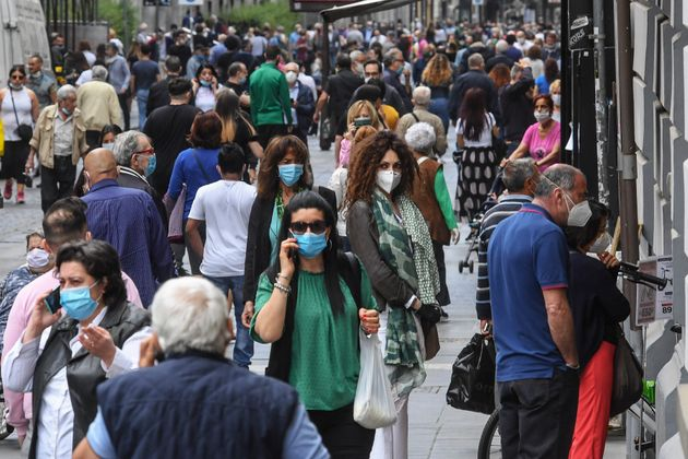 NAPLES, CAMPANIA, ITALY - 2020/05/19: A crowd of people wearing protective masks walk in Naples center....