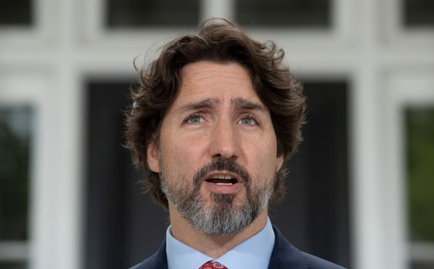Prime Minister Justin Trudeau speaks during a news conference outside Rideau Cottage in Ottawa on May...