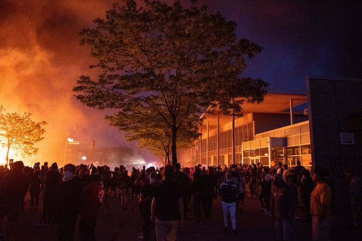 A crowd watches a pawnshop burn to the ground on Thursday night. It was the third day of protests over the death of George Fl