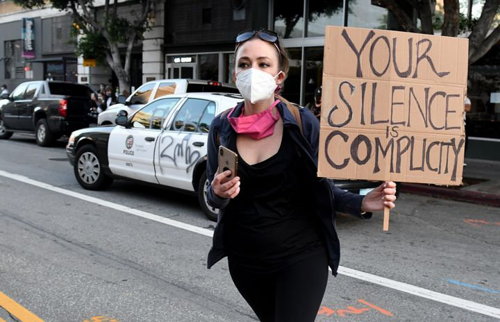 A demonstrator protests the death of George Floyd in Los Angeles on May 28, 2020.
