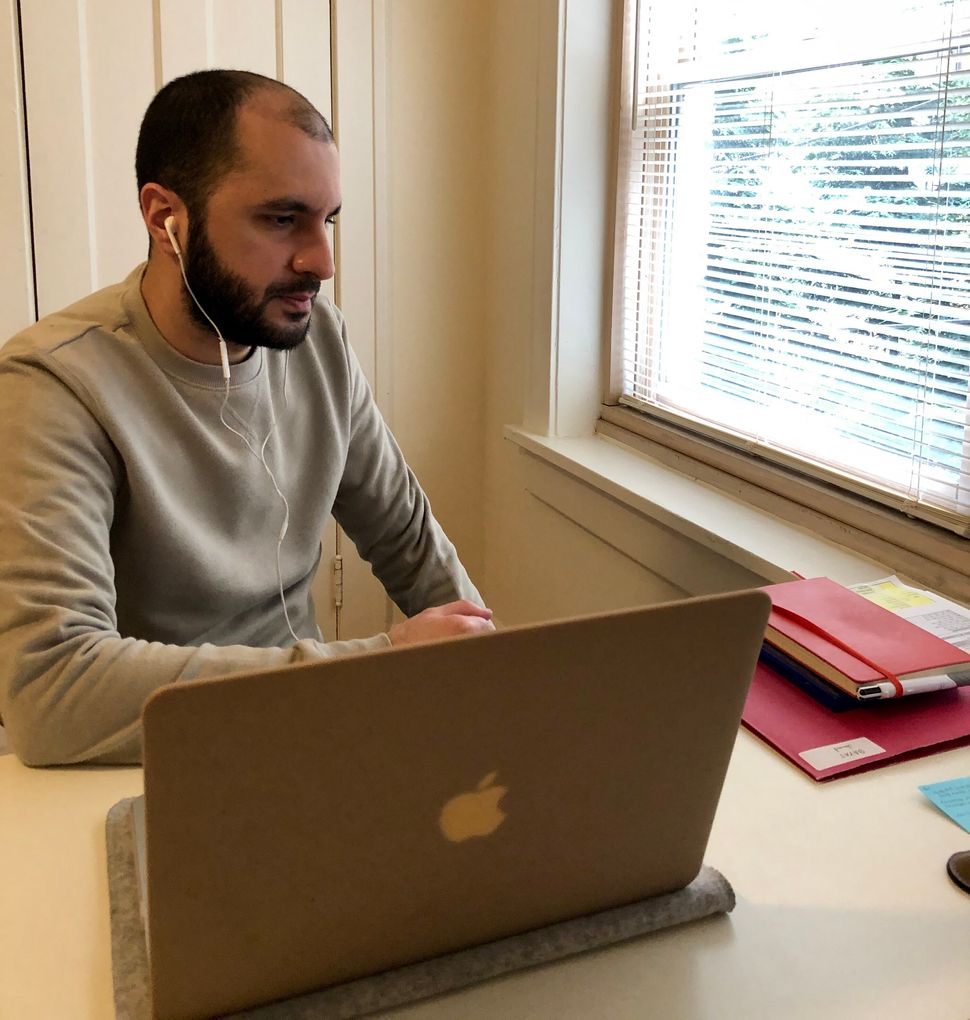 Imam Jawad Bayat, a chaplain at the Cleveland Clinic, conducts a telehealth session with a patient.