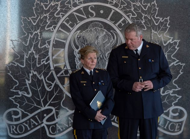 RCMP Assistant Commissioner Lee Bergerman, left, and Chief Superintendent Chris Leather wait for the...