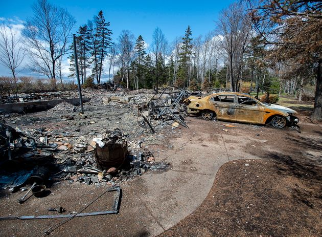 A fire-destroyed property registered to the N.S. shooter is seen on May 8,