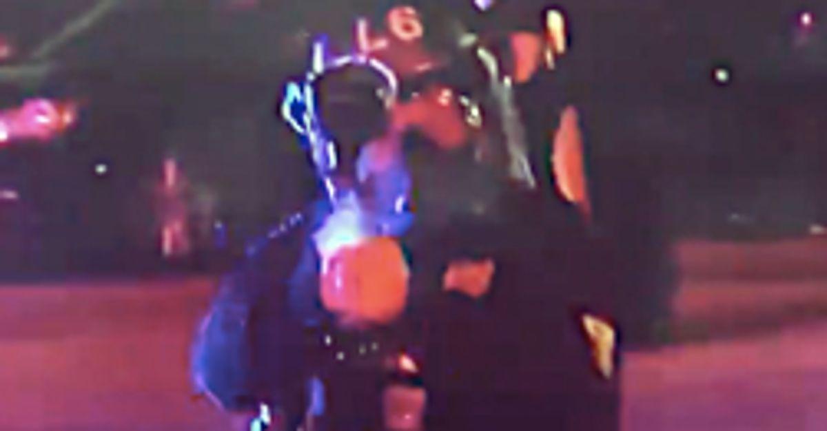 Police Officer Fires Pepper Pellets At Journalist During Live Protest Broadcast