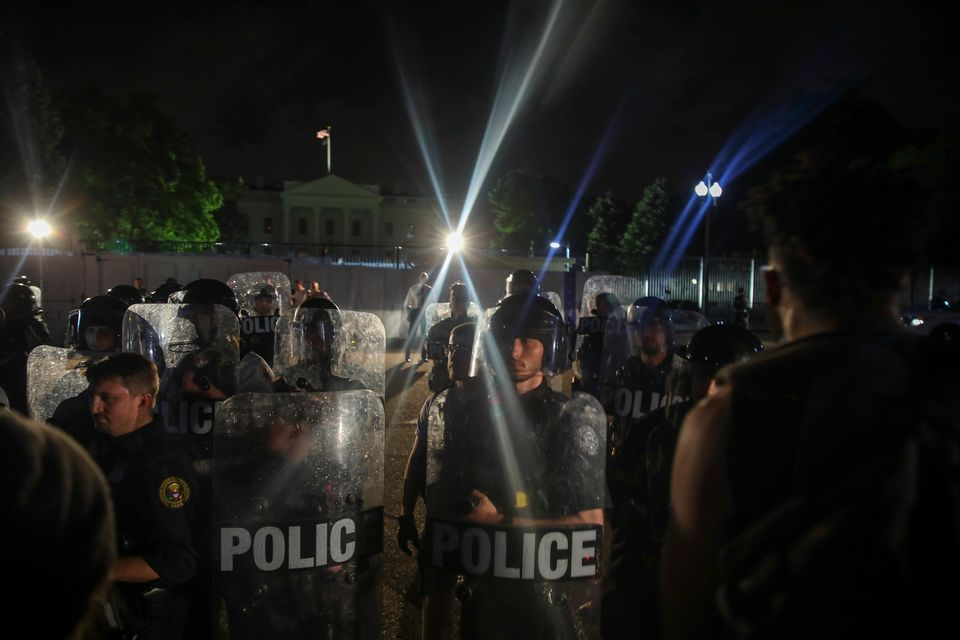 Police work to keep demonstrators back during a protest in Lafayette Square Park near the White House...