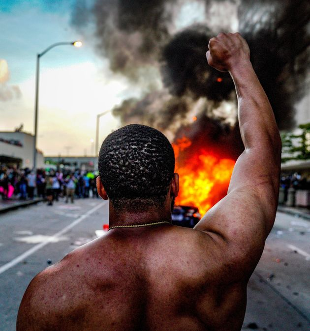 ATLANTA, USA - MAY 29: Protesters set a police vehicle on fire during a protest following the death of...