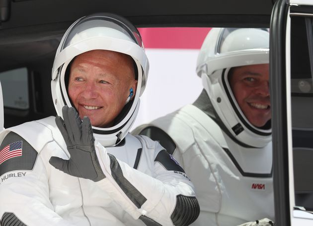 NASA astronauts Bob Behnken (right) and Doug Hurley, best friends, in a vehicle prior to the SpaceX launch...