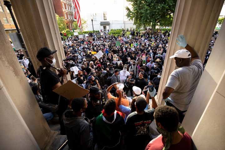 Protesters gathered outside of City Hall after a peaceful march across the city on May 29 in Louisville.