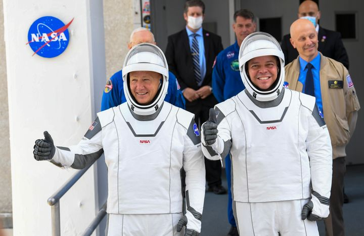 NASA commercial crew astronauts Doug Hurley, left and Bob Behnken, right, leave for their flight aboard the SpaceX Falcon 9 rocket bound for the International Space Station.
