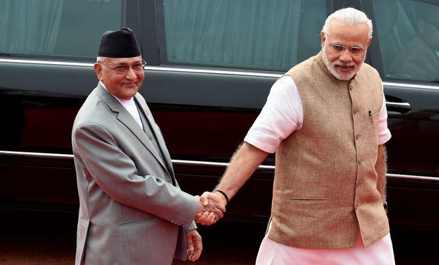 Prime Minister Narendra Modi and Nepal Prime Minister KP Oli during a ceremonial reception in New Delhi...