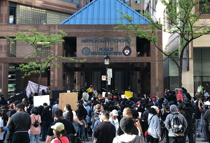 People gathered in front of Toronto police headquarters demanding justice in the death of 29-year-old Regis Korchinski-Paquet.