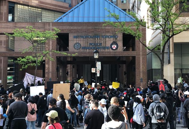 People gathered in front of Toronto police headquarters demanding justice in the death of 29-year-old...