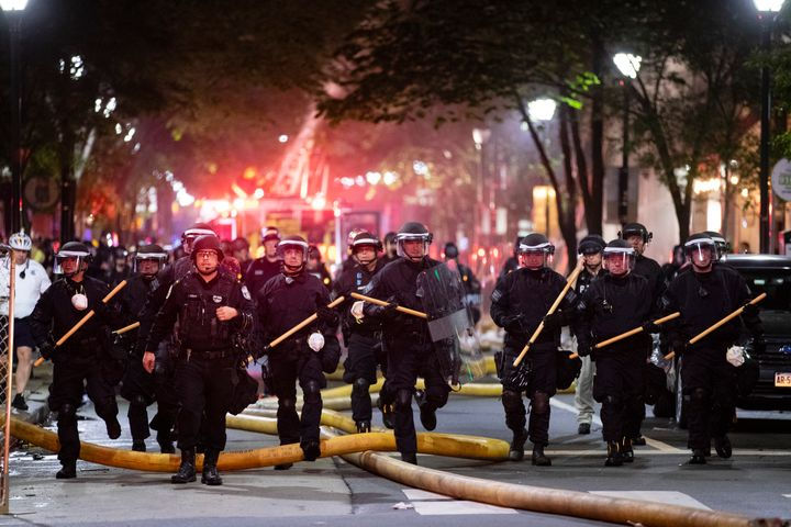Police push down a street in Philadelphia on May 30, 2020 during a protest over the death of George Floyd.