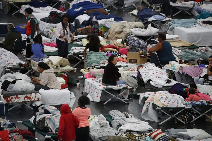 People are seen sheltering at the George R. Brown Convention Center in Houston after floodwaters from Hurricane Harvey inundated the city in 2017.