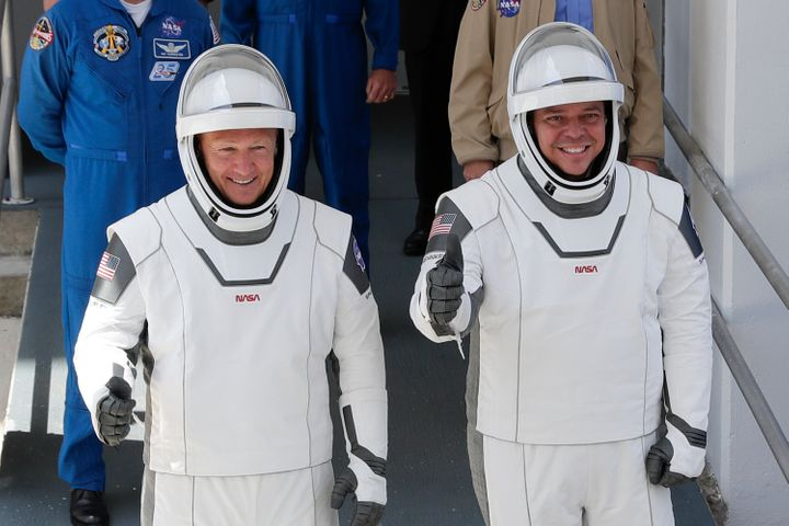 NASA astronauts Douglas Hurley, left, and Robert Behnken make their way to Pad 39-A, at the Kennedy Space Center in Cape Cana
