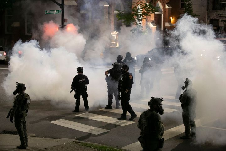 Police in Raleigh, North Carolina, fire tear gas to disperse a crowd of demonstrators in front of the First Baptist Church early Sunday morning.