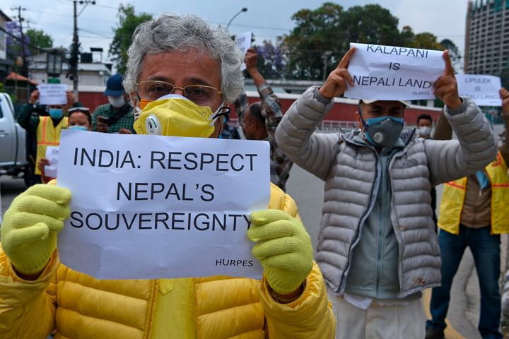 Activists hold placards during a protest against India's newly inaugurated road, near the Indian embassy in Kathmandu on May 12, 2020.